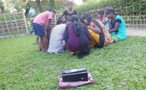 Children from the nearby tea garden waits in anticipation to listen to Radio Brahmaputra.