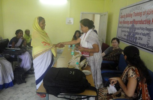 Dr SewaliDevi, JDH congratulating an Asha for her being declared the best performer in family planning.