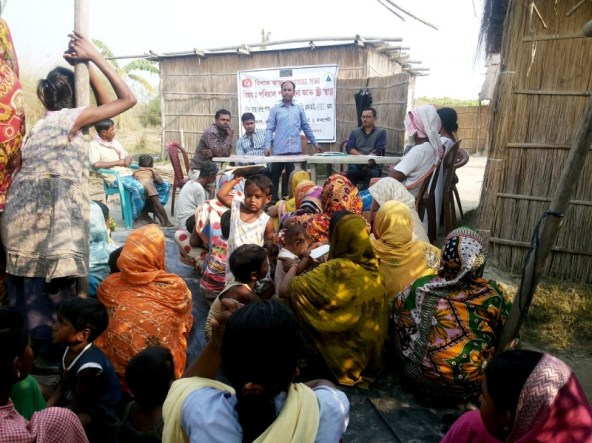 The Family Planning Counsellor,Noor Jamal, Barpeta Boat Clinic Unit I speaking to villagers on family planning methods during an awareness camp at Hapsa char.