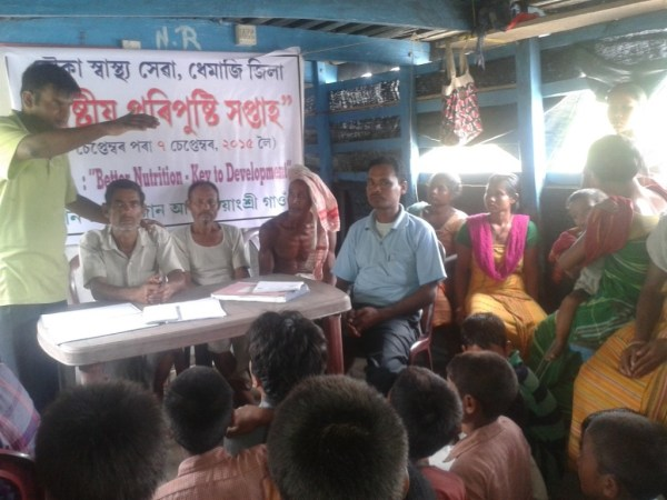 Medical Officer, Dhemaji Boat Clinic Dr Rahul Mistri interacting with villagers of Sirangshree village, on board the Boat Clinic on the occasion of the Food and Nutrition Week in September 2015