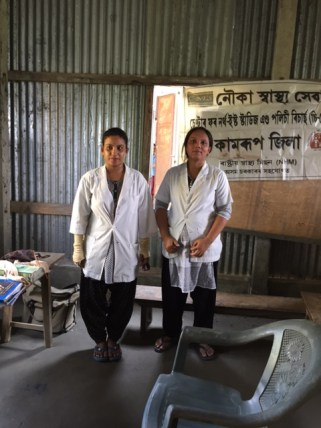 The long walk to the village in the interior of the island in peak summer heat (left) Bhanita Talukder and Padumi Kalita, ANMs of the Kamrup Boat Clinic unit at the health camp