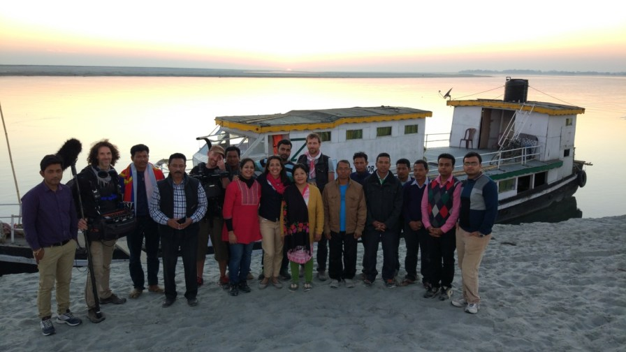 the Jorhat Boat Clinic team and the visiting media group with the Boat Clinic Nahor and the mighty Brahmaputra beyond as backdrop