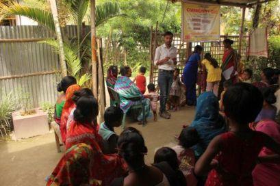 The radio station coordinator Bhaskar Bhuyan facilitating a community quiz in a slum pocket
