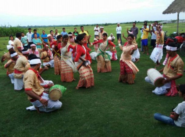 The photographs show the visitors meeting people, interacting with beneficiaries and the health team including Bihu being performed by the community for the visitors