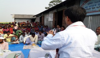 Joint Director of Health Service Dr. Dilip Basumatari speaking on Vit-A and other concurrent health issues at Bongaigaon island village