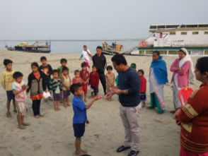 Children being taught oral hygiene by the dentist under Boat Clinic Jorhat