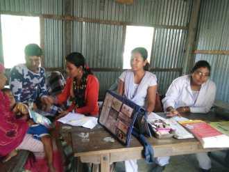 The Barpeta Unit II team at the Health Mela at Baghbar village with the Mandia Block PHC