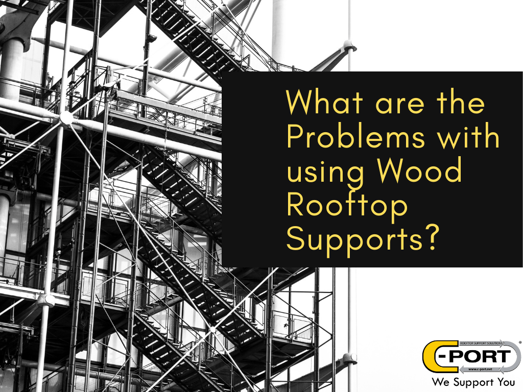 What are the problems with using wood rooftop pipe supports?