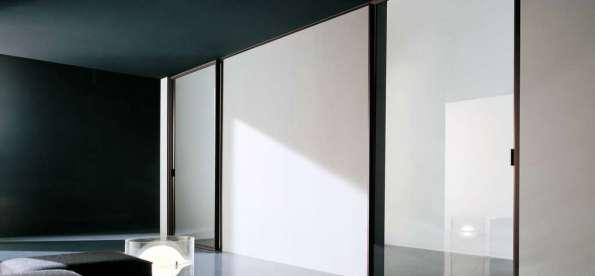 Las puertas corredizas con espejo para armarios for Puertas automaticas cristal