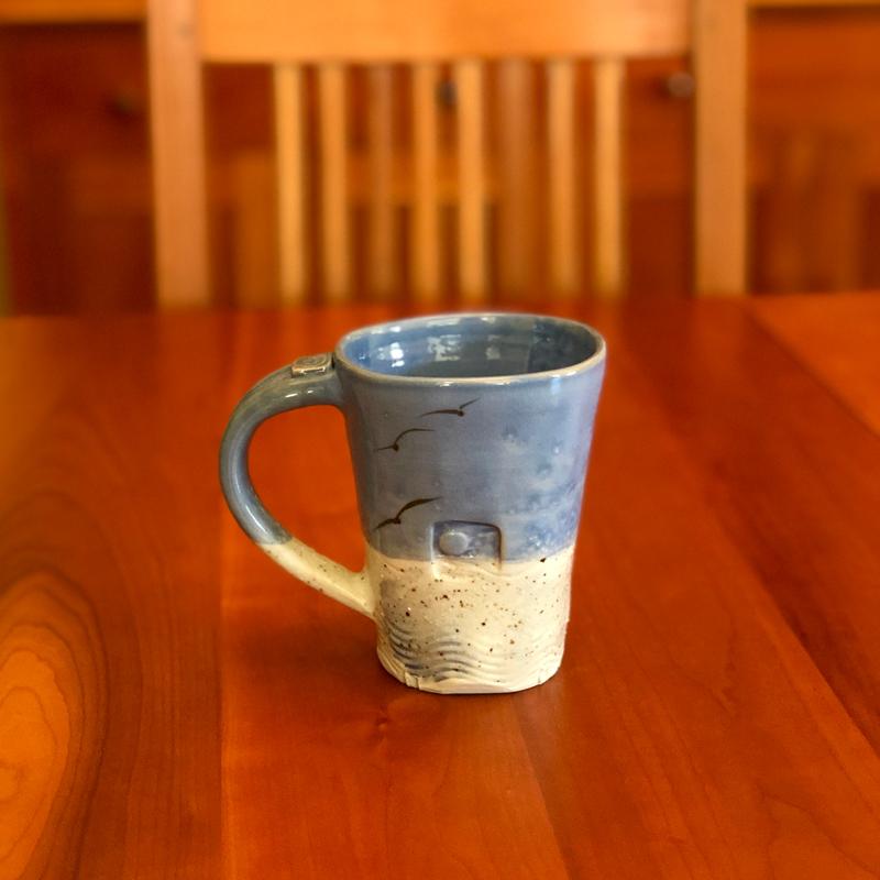 handmade ceramic mugs with beach sand in the glaze