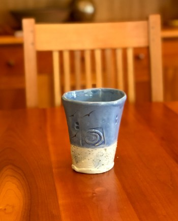 handmade ceramic tumbler with blue glaze and beach sand