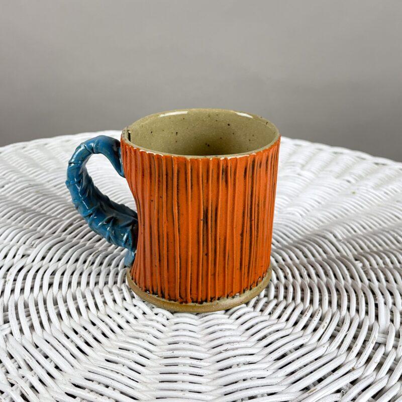Orange handmade ceramic mug