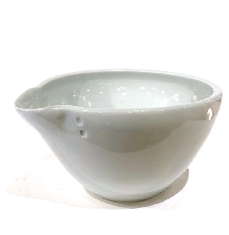 handmade bowl with spout to pour out batter or soup