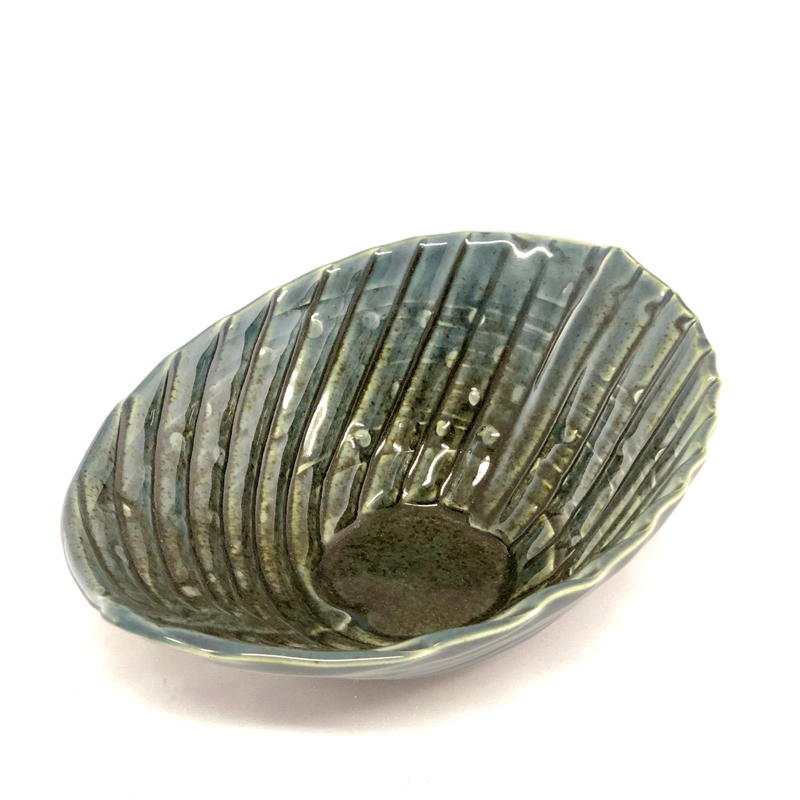 oval shaped bowl, handmade, has textured lines