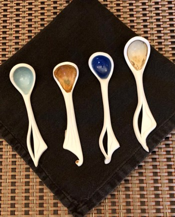4 porcelain spoons on a table
