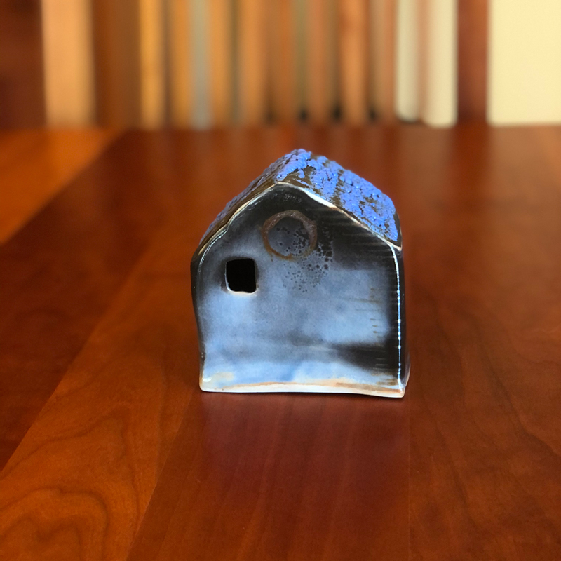 little blue and black ceramic decorative house
