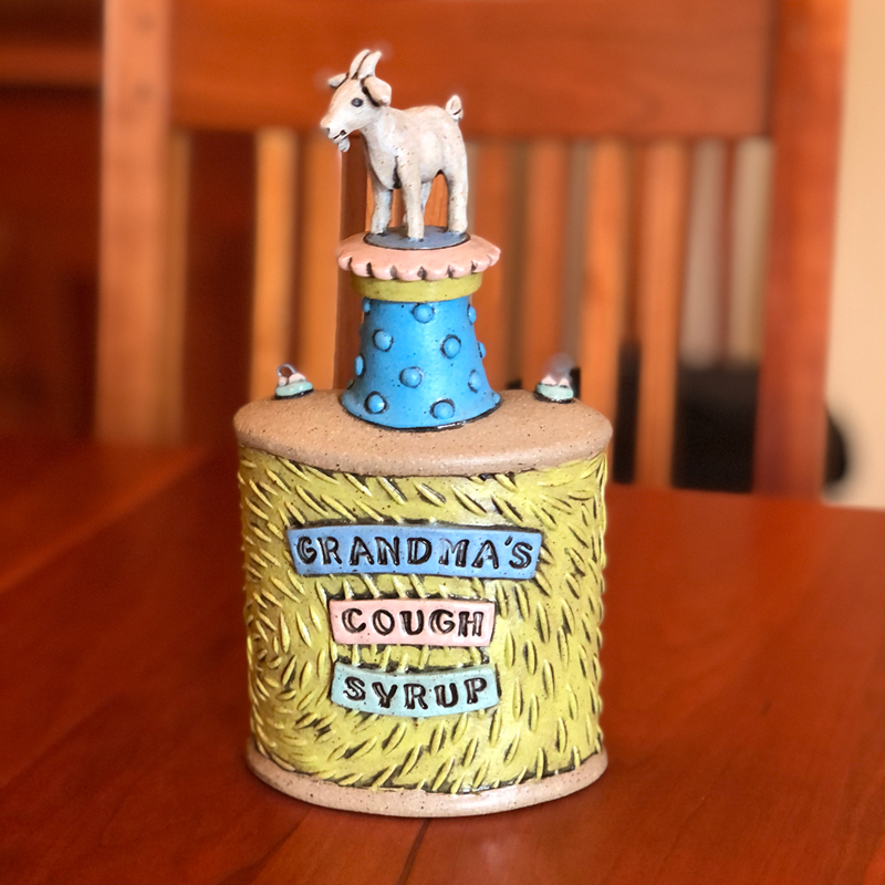 handmade ceramic flask that says grandma's cough syrup