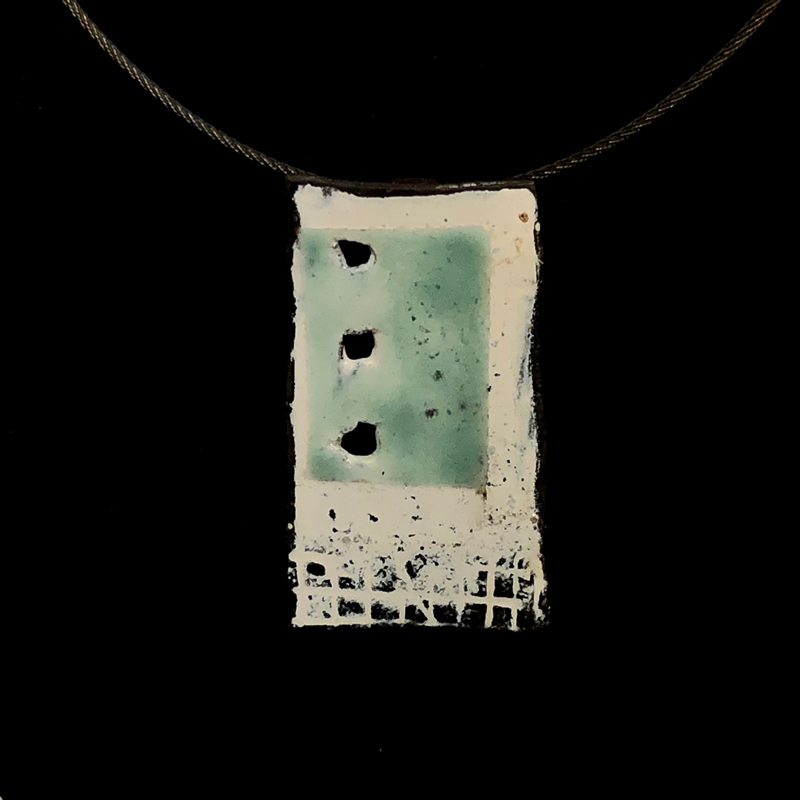 handmade enameled steel pendant with some texture, in aqua and white