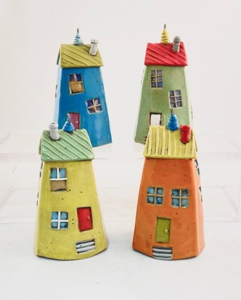 4 bell ornaments in the shape of houses