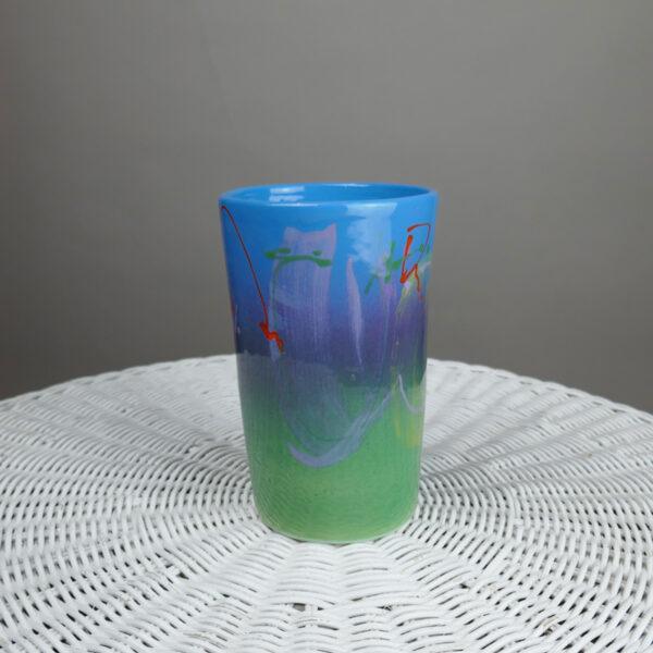 ceramic vase or kitchen utensil holder or wine bottle cooler