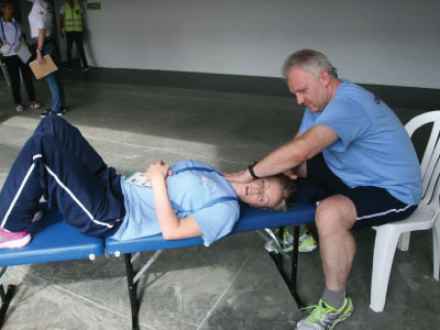Rainer Wieser treating fellow chiropractor at Columbia World Games 2013