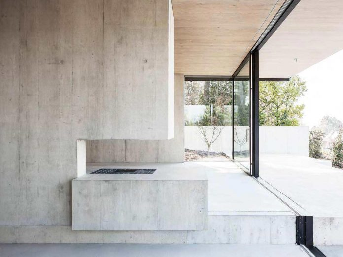 modern-house-riehen-made-glass-concrete-wood-metal-serve-designed-reuter-raeber-architects-06