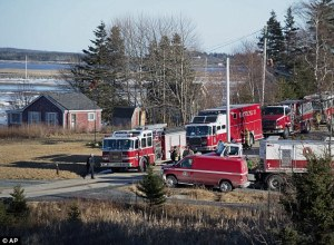 The above cottage in Grand Desert is one of two homes where authorities found hazarous chemicals. Firefighters and other emergency personnel seen gathered around the building on Wednesday.