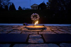 """A burning flame can be found on the official """"grave"""" of JFK, which symbolizes a major Illuminati operation. The same burning flame can also be found on the grave of Princess Diana and on the Mahatma Gandhi memorial."""