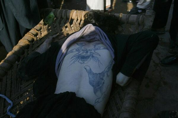 The Satanic tattoo in question, on the back of the dead Caucasian attacker. He also had a gold tooth.