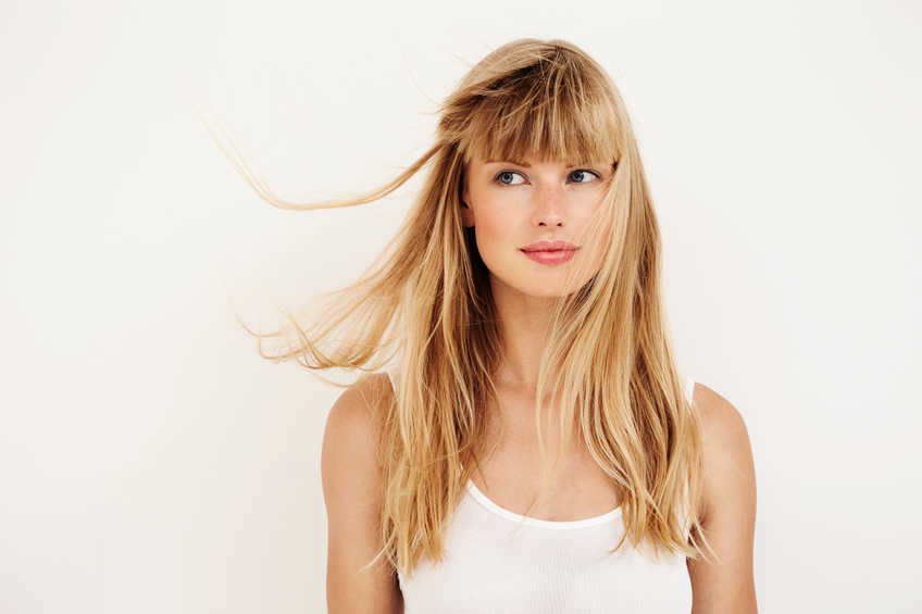 Windswept young woman with blond hair
