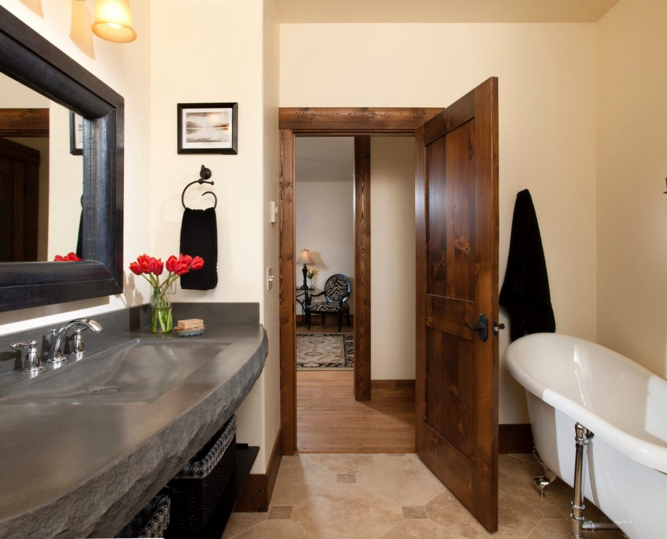 Bathroom in Ebony Suite with luxury sink and soaker tub about us