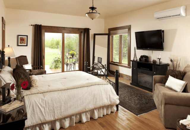 rooms gallery elegant master bedroom in the Chocolate Suite with Electrical fireplace and view of sliding glass door
