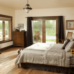 Cabin Creek Landing FAQs rooms gallery elegant and comfortable master bed room in Twin Falls Room with electric wooden fireplace