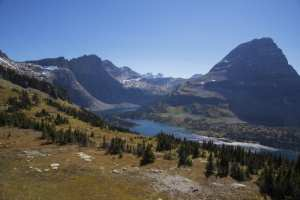 glacier national park majestic natural scene with mountains and a river in the surrounding area