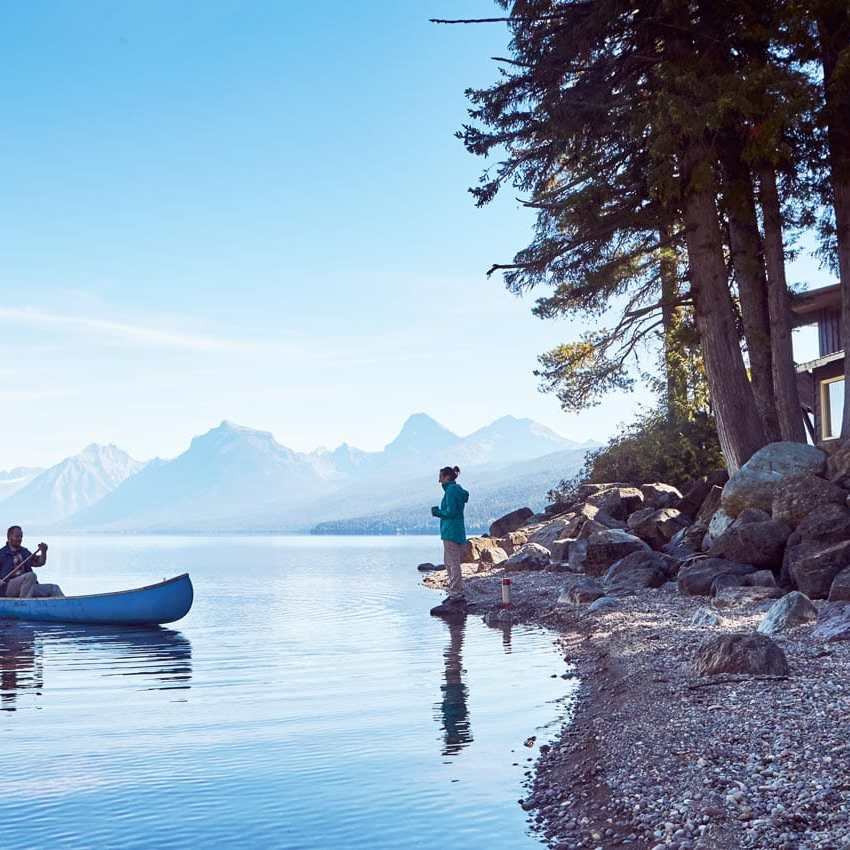 canoe in lake with amazing view