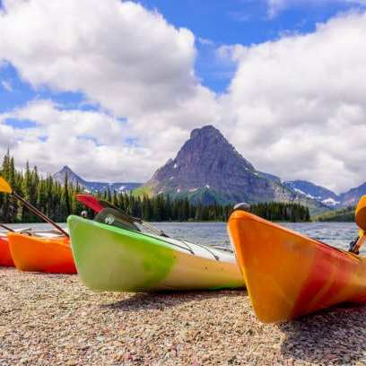 glacier national park Several canoes lakeside with a great mountain view bets bed and breakfast in montana wedding services wedding Planning