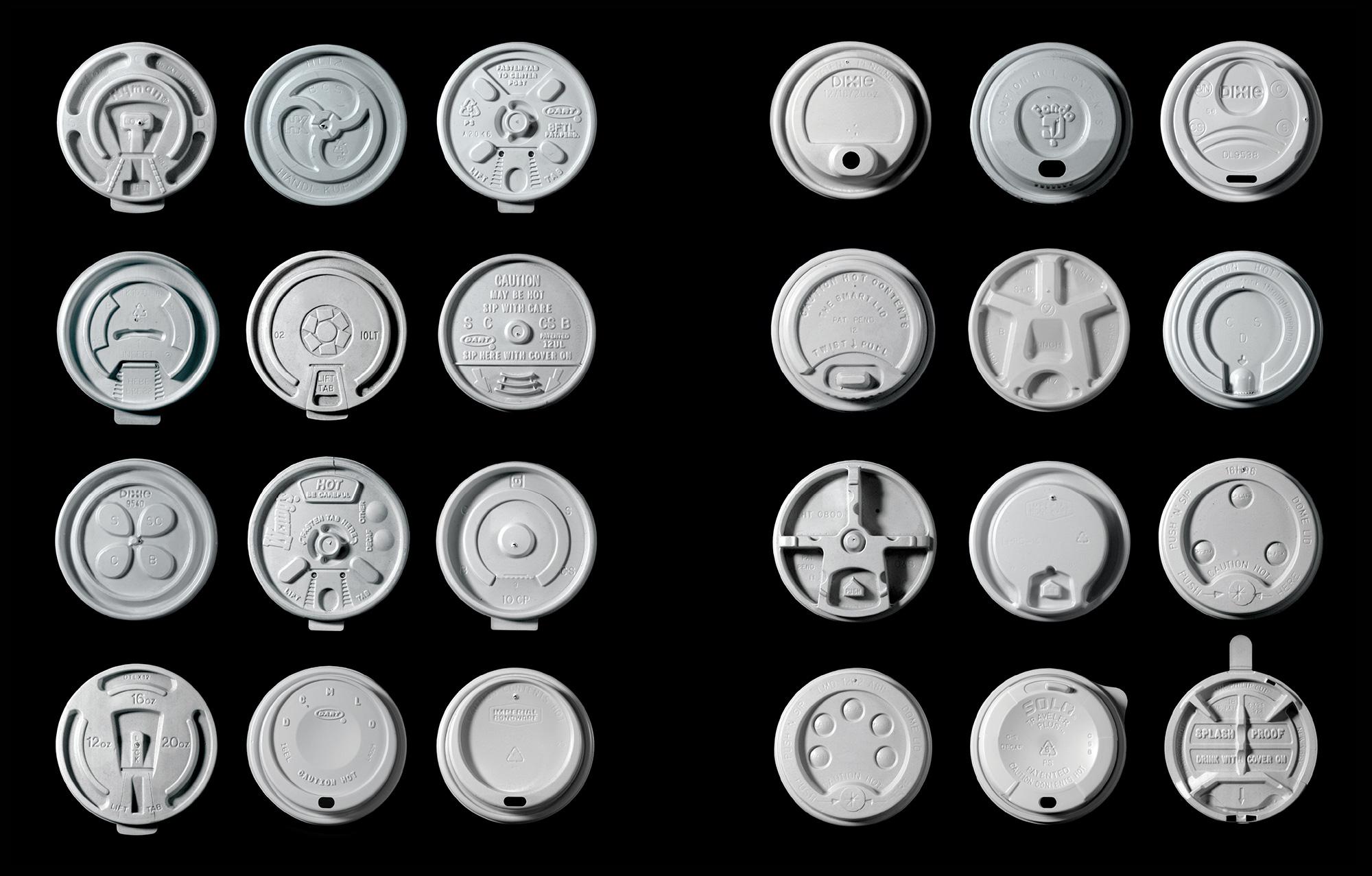 Rows of plastic coffee lids.