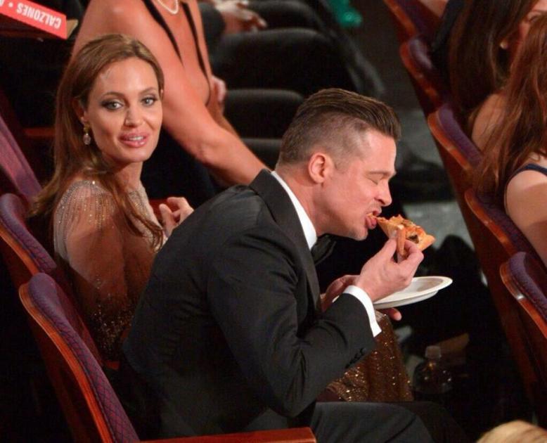 Brad Pitt eating Ellen's pizza
