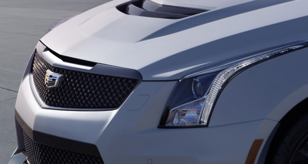 Almost every exterior panel on the 2016 Cadillac ATS-V coupe is unique, from the fascias and fenders, to the hood, rear spoiler and rocker moldings – and every one was designed to support the car's capability. A lightweight carbon fiber hood, front and fascia designed with larger grille openings to feed more air to the new twin-turbocharged engine. Even the mesh pattern of the signature grille openings is enlarged to allow more air into the radiator and multiple heat exchangers. Image: GM Media