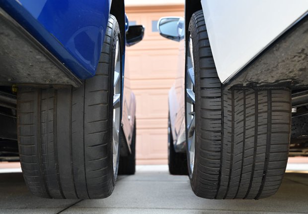 The Pilot Super Sport (left) and the Pilot Sport All-Season 3+. The two tires' similarities are noticeable. The PSS on the left, which is on our ATS-V manual Coupe, gets run pretty hard. The PS AS3+ on the right, is on our ATS-V automatic Sedan and doesn't get run quite as hard. Plus it gets driven more in the winter. Image: V-Net staff.