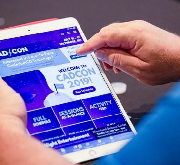 A CadCon attendee using CadmiumCD's eventScribe App