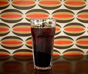 Cold Brew Coffee Recipes are easy and make both tasty and pretty cold brew coffee like the tall glass filled with ice and cold brew Ladro coffee