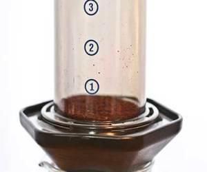 Aeropress with coffee grinds inside
