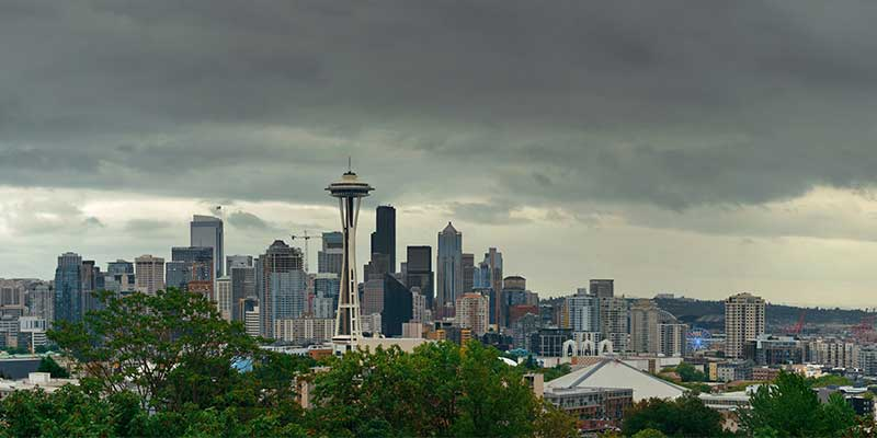 Seattle's Long Gray Winter shown with a cloudy backdrop to the Seattle skyline