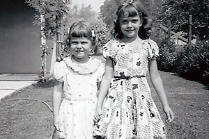 Gail (4) and Carol Ann (7) near the front porch of their home, 1955.