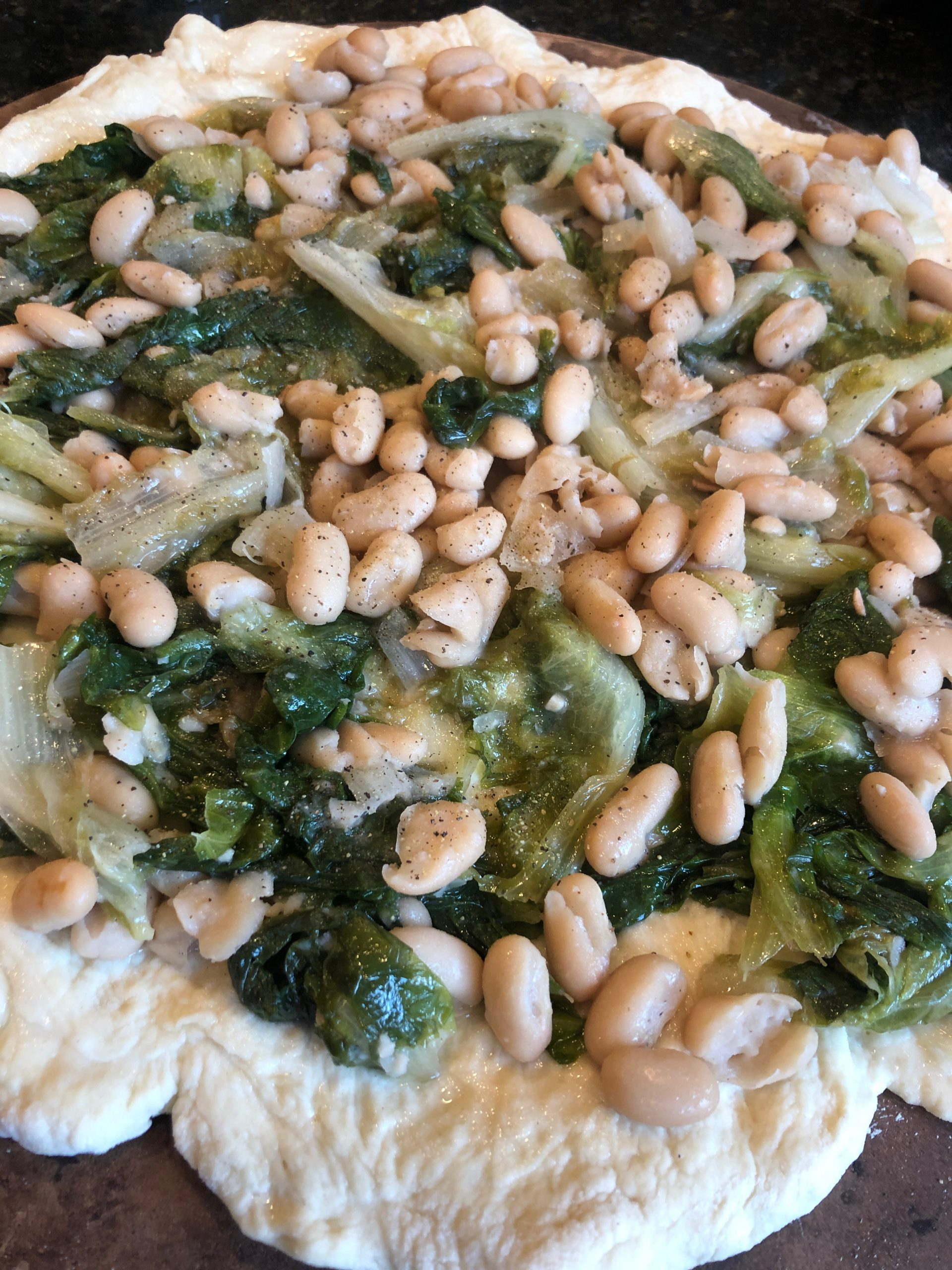 escarole and bean pizza before its cookied