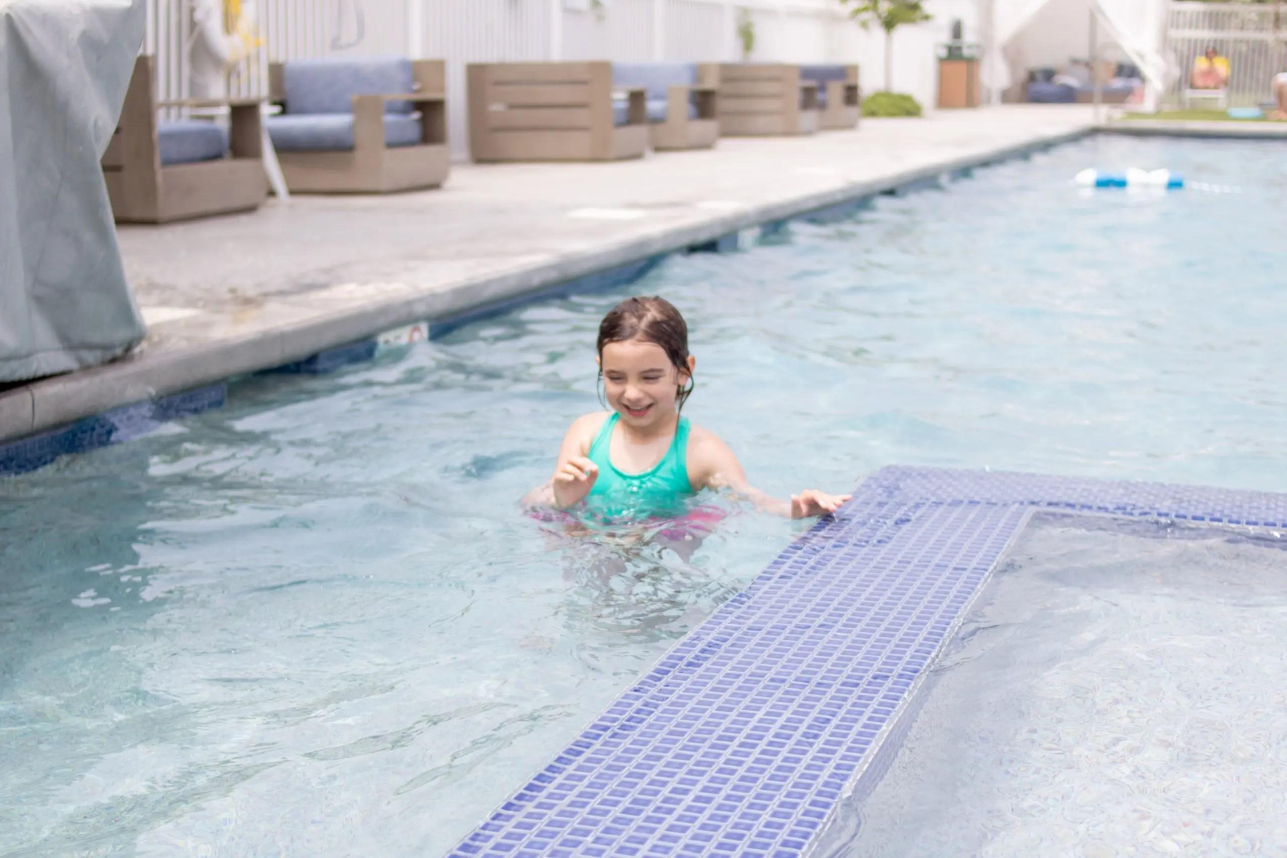 little girl in pool at winnetu