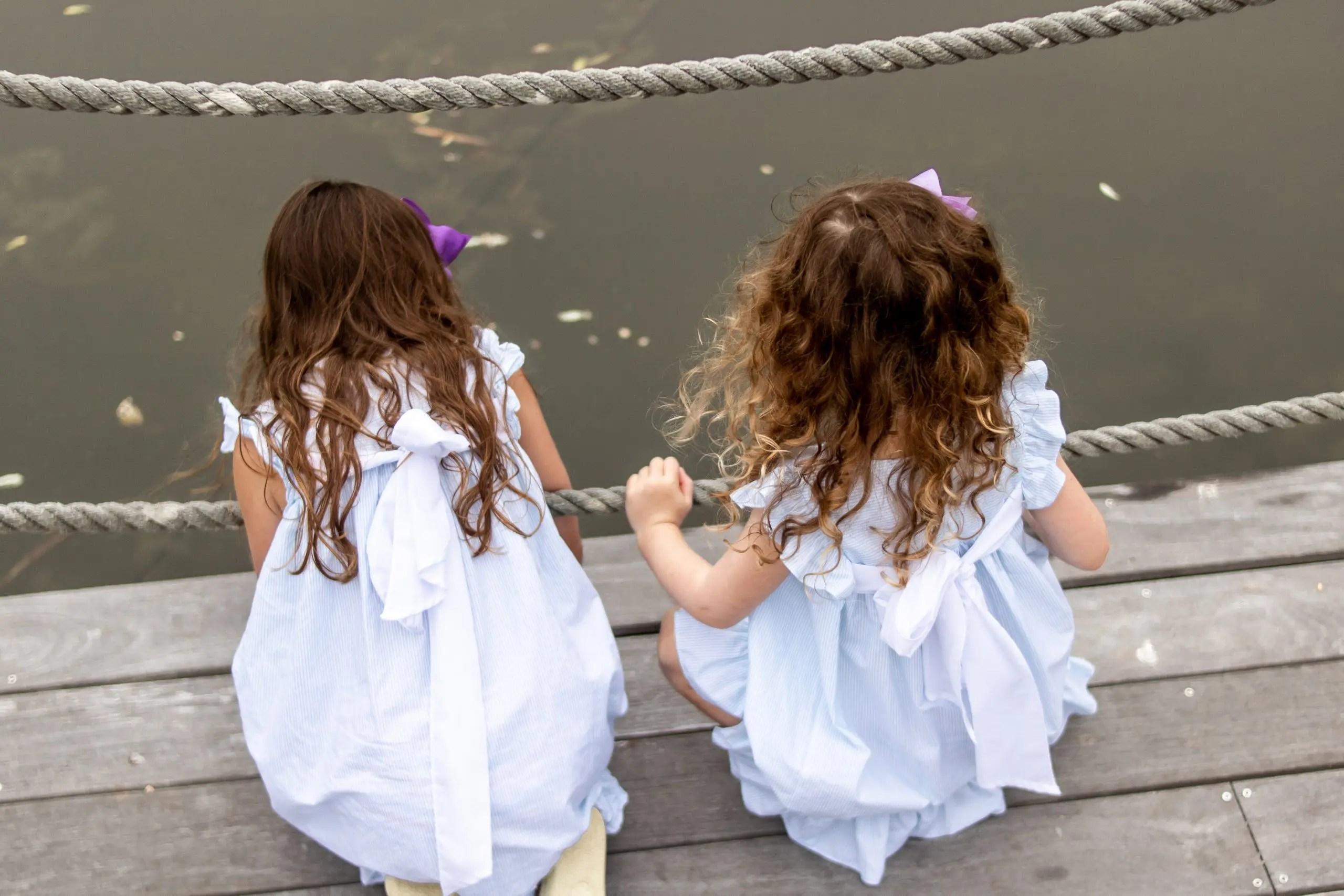 little girls looking at turtle pond at Winnetu