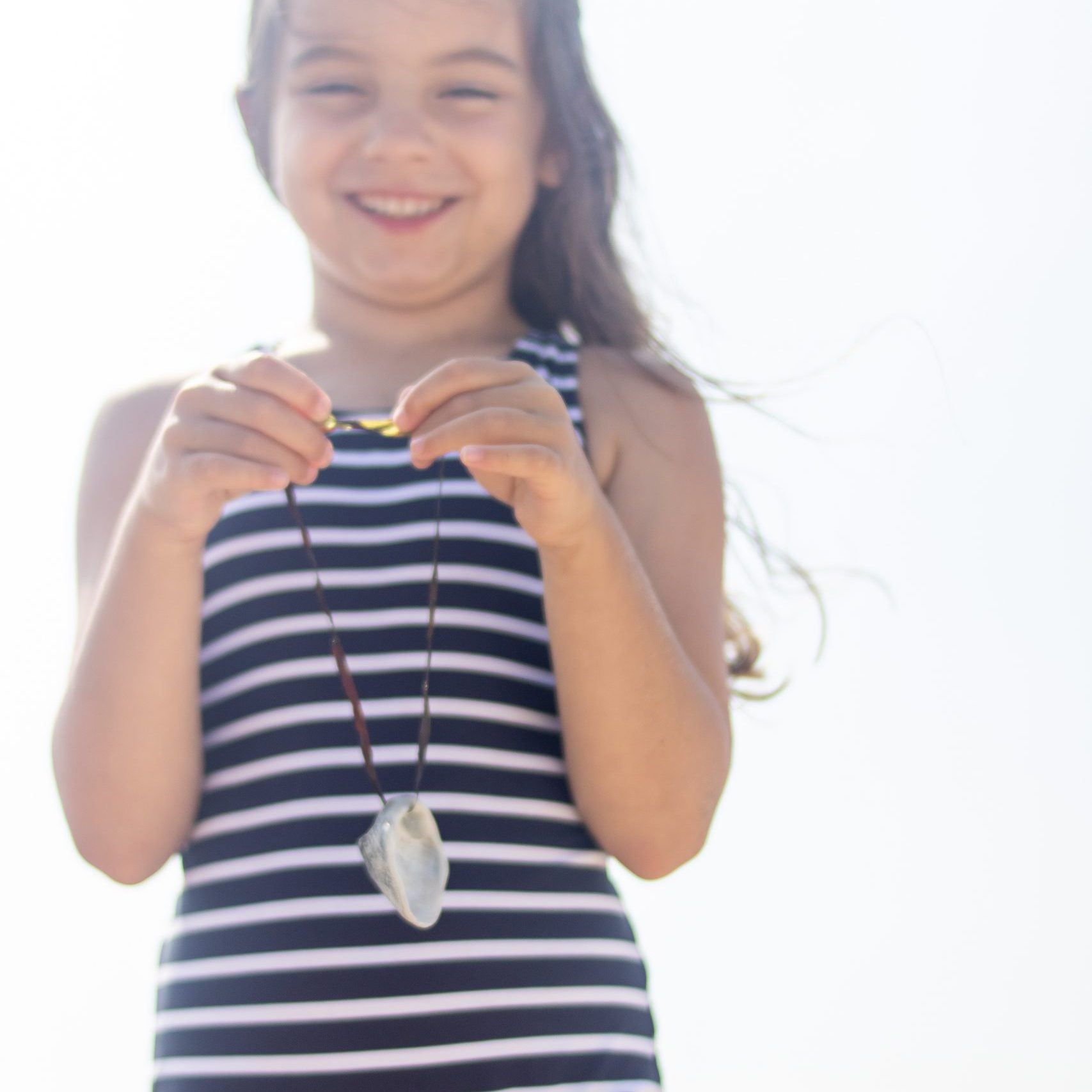 little girl with seashell necklace