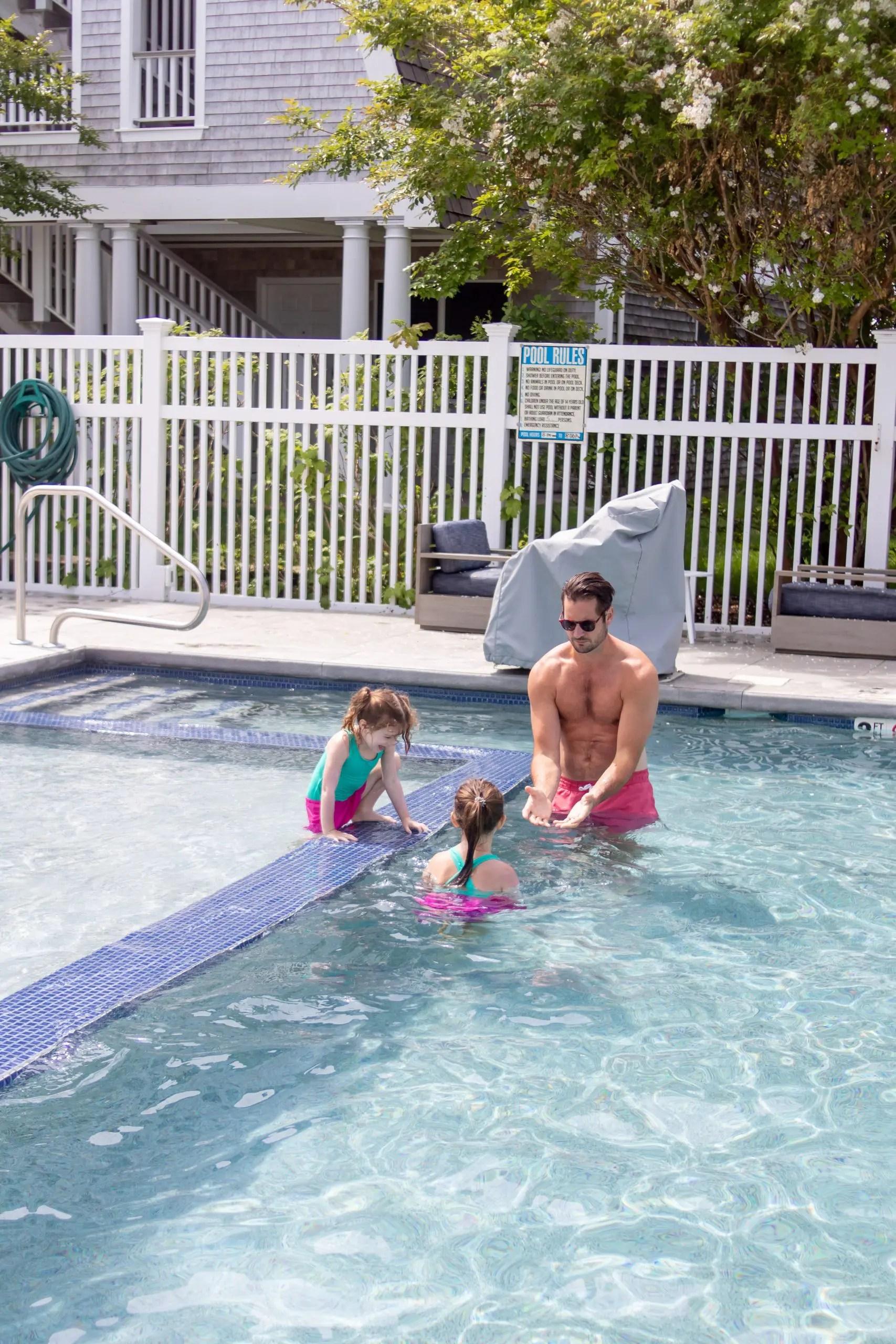 little girl swimming in the pool winnetu